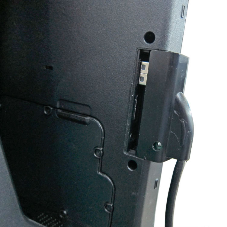 Rear view of the waterproof USB interface extension dongle for the Getac F110 tablet being installedin the F110 chassis